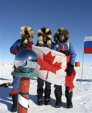 Canadian adventurers Ray Zahab, left, Kevin Vallely, center, and Richard Weber, right, are pictured at the South Pole on Thursday. South Pole Quest via AP